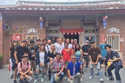Exchange students taking a group photo in front of Hsiao Family Old House.